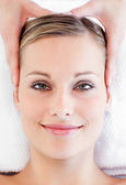 Young smiling woman receiving a head massage — Stock Photo
