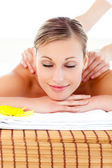 Portrait of a bright woman lying on a massage table — Stock Photo