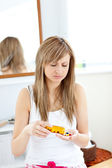 Diseased woman taking pills in her bathroom — Stock Photo
