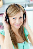 Bright caucasian woman listening to music with headphones in the — Stock Photo