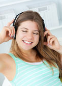 Good-looking girl listening to music — Stock Photo