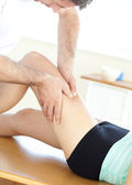 Young woman receiving a leg massage in a health club — Stock Photo