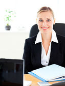 Self-assured young businesswoman sitting at her desk — Stock Photo