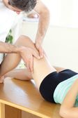 Caucasian woman receiving a leg massage in a health club — Stock Photo