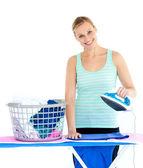 Cute woman ironing — Stock Photo