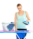 Unhappy woman ironing — Stock Photo