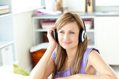 Kind woman listening to music at home — Stock Photo
