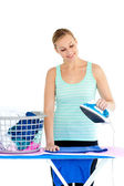 Bright woman ironing her clothes — Stock Photo