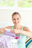 Positive young woman doing the laundry — Stock Photo