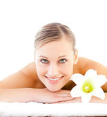 Close-up of a positive woman lying on a massage table with a flo — Stock Photo