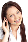 Cheerful young businesswoman with earpiece — Stock Photo