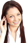 Smiling young businesswoman wearing headphones — Stock Photo