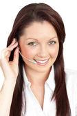 Merry young businesswoman wearing headphones — Stock Photo