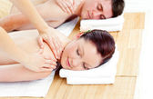 Young caucasian couple receiving a back massage — Stock Photo
