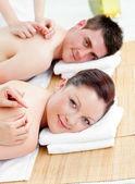 Charming caucasian couple receiving a back massage — Stock Photo
