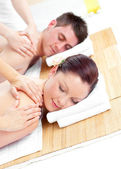 Attractive young couple receiving a back massage — Stock Photo