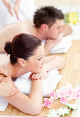 Attractive young couple enjoying a back massage — Stock Photo