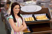 Self-assured female cook smiling at the camera — Stock Photo