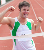 Exulting sprinter showing expression of victory in front of the — Stock Photo