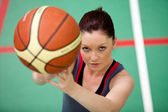 Portrait of an athletic young woman playing basket-ball — Stock Photo