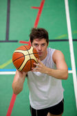Portrait of a muscular young man playing basket-ball — Stock Photo