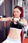 Positive athletic woman using a bench press — Stock Photo