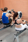 Sportsmen using a rower — Foto de Stock