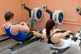 Concentrated using a rower — Stockfoto