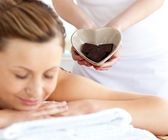 Relaxed woman lying on a massage table — Stock Photo