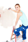 Animated woman painting a room — Stock Photo