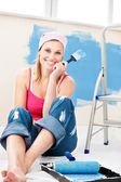 Cheerful woman painting a room — Stock Photo