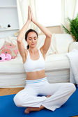 Bright woman practicing yoga in her living-room — Foto Stock