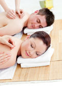 Relaxed caucasian couple receiving a back massage — Stock Photo