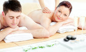 Attractive caucasian couple receiving a back massage — Stock Photo