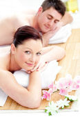 Relaxed young couple enjoying a back massage — Stock Photo