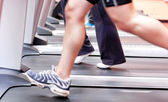 Close-up of the legs of an athletic young woman exercising on a — Stock Photo