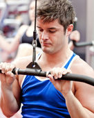 Self-assured male athlete practicing body-building — Stock Photo