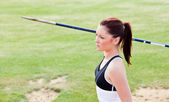 Concentrated female athlete ready to throw javelin — Stock Photo