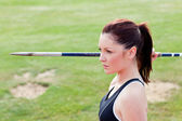 Concentrated athletic woman ready to throw the javelin — Stock Photo