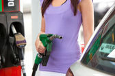Close-up of a caucasian woman refueling her car — Stock Photo