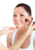 Cute woman being applied powder on her face — Stock Photo