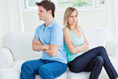 Young caucasian couple sulking after a conversation sitting back — Stock Photo