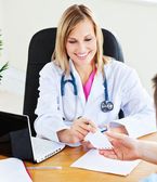 Woman doctor giving notice to her male patient — Stock Photo