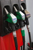 Gasoline pumps nozzles at petrol station — Stock Photo
