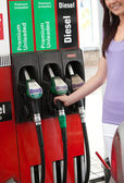 Young woman at the pump — Stock Photo