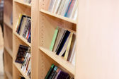Close-up of a bookshelves in a library at the university — Stock Photo