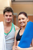 Portrait of a happy couple after fitness exercices smiling to th — Stock Photo
