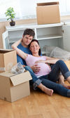 Future parents relaxing on the floor during a break after unpack — Stock Photo
