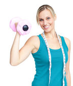 Young woman holdng a dumbbell — Stock Photo