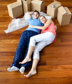 Young couple lying on floor — Stock Photo
